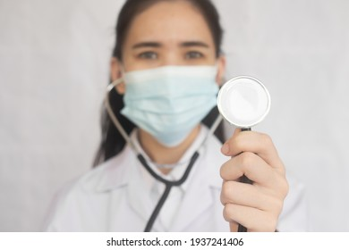Close up Doctor hold stethoscope standing copy spec