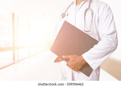 Close up of doctor holding medical records in healthcare concept on sun light