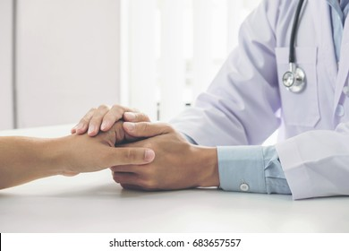 Close up of doctor touching patient hand for encouragement and empathy on the hospital, cheering and support patient, Bad news, medical examination, trust and ethics