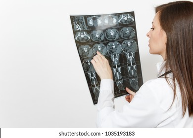 Close up doctor woman holds x-ray radiographic image ct scan mri isolated on white background. Female doctor in medical gown stethoscope. Healthcare personnel, radiology medicine concept. Back view