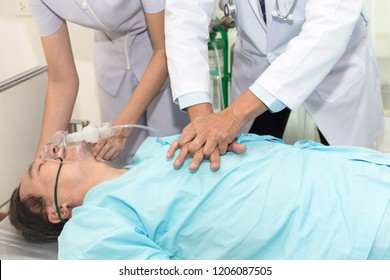 close up of doctors giving cardiac massage and resuscitation to a male patient in the emergency room