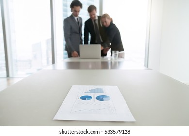 Close up of a document with charts, business people analyzing data of survey, understanding and targeting buyer personas, preparing presentation, free business analyst training courses online