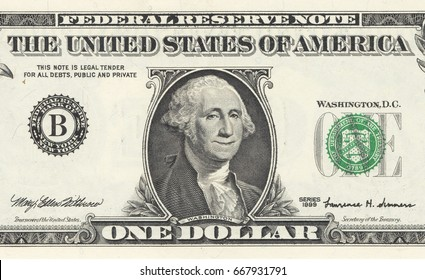 Close up dollar bill. George Washington is happy with smiling face.