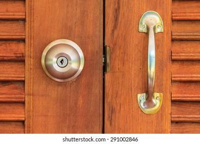 close up of doorknob with wooden door