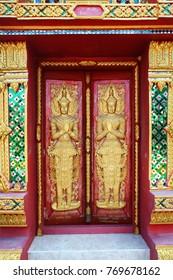 close up doors bass-relief in Beautiful temple Wat Samai Kongka on Ko Pha Ngan, Thailand.