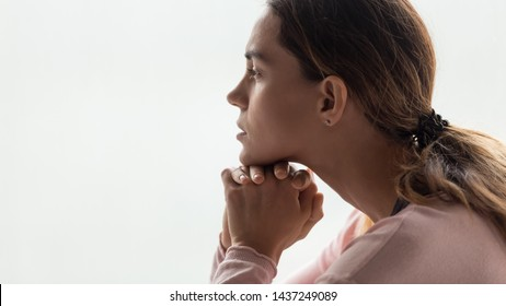 Close up of dreamy millennial girl look in distance thinking of problem solution or imagining, thoughtful pensive young woman lost in thoughts dreaming or visualizing, pondering over relationships