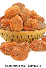 close up of dried apricots in a basket