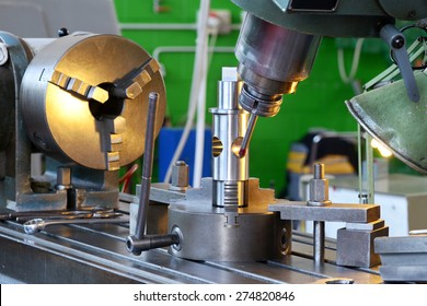 Close Up of Drilling Machine Demonstrating Precision During Manufacturing of Machine Parts