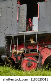 Close up of a drivers cabine and wheels of an old steam funicular in Austria.