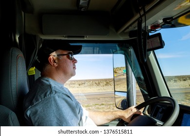 Close up of driver's hands on big truck steering wheel