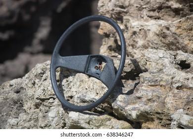 close up driving a rock