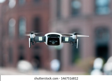 Close up of drone quadcopter inflight. Cityscape background. remote controlled wireless quadcopter drone with video and photo camera for aerial photography flying in the air outdoors