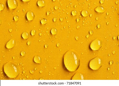 Close up of drops on yellow umbrella