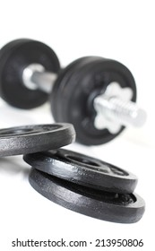 Close up of dumbbell weights isolated over white background. Fitness bodybuilding concept.