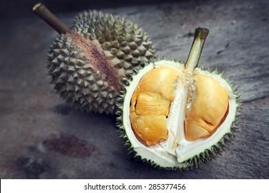 Close up of durian with orange yellowish flesh.