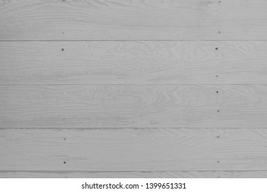 Close up dust white color wood substitute board and high quality of fiber board  texture and background for design and architect, Beautiful wooden plank patterns from cement striped wood wall