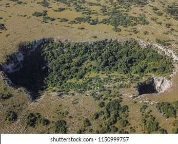Close to Duvno Polje (Duvanjsko polje) of western Bosnia and Herzegovina is a series of steep of collapse sinkholes (collapse dolines) which are known as Samogradi.