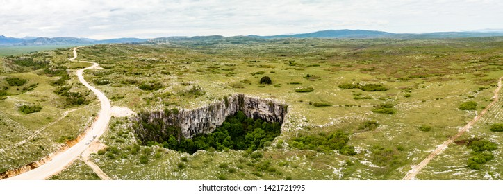 Close to Duvno Polje (Duvanjsko polje) of western Bosnia and Herzegovina is a series of steep of collapse sinkholes (collapse dolines; collapse caves) which are known as Samogradi (Samograd)