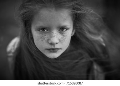 Close up dynamic portrait of teenager girl with freckles. Black and white