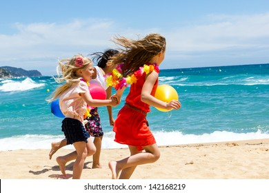 Close up dynamic shot of youngsters running on beach.