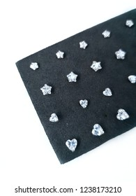 Close up of earring minimal style jewelry daimond silvers is stars and heart.