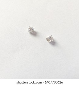 Close up of earring minimal style jewelry daimond silvers is earring,on white background minimal style.