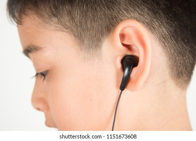 Close up ear's boy use earphone listen the music from the phone
