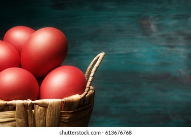 Close up of Easter red eggs in basket