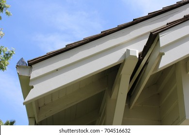 Close up of eaves and deep overhangs and fascia boards on early 20th century house built from a kit. The notched ends alert home builder which board end goes toward edge.