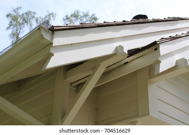 Close up of eaves and overhangs and fascia boards on early 20th century house built from a kit. The notched ends alert home builder which board end goes toward edge.