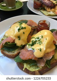 Close up Egg Benedict with Salmon and hollandaise sauce