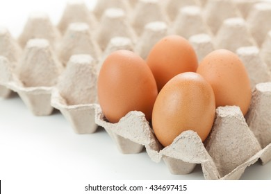Close up of eggs on rag. or cartons packing. on white background.