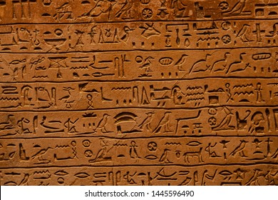close up of Egyptian hieroglyphs carved in stone