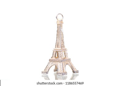 Close up of an Eiffel tower keychain isolated on a white background