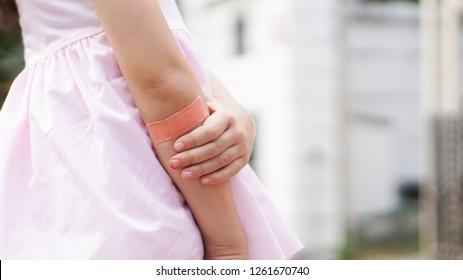 Close up elbow little girl having bandage sticking