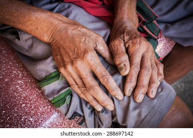 close up of elderly man's withered and rough hand