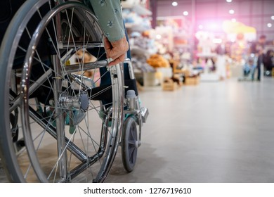 Close up of elderly on wheelchair in supermarket.