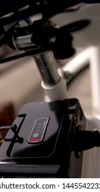 Close up of the electric bicycle battery pack with switch on the powered ebike and sign Li-ion type with level.