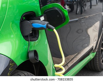 Close up of electric car being charging