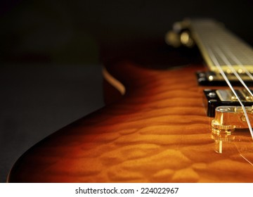 Close up of an electric guitar with dark copy space