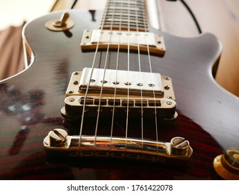Close up electric guitar pickups and strings.