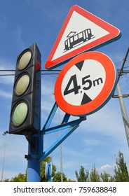 Close up Electric Train Sign and Traffic light blue sky Alicante Spain