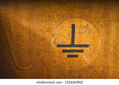Close up of an electrical grounding symbol on an train wagon