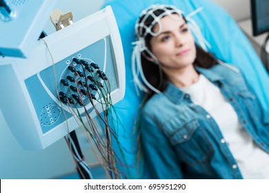 Close up of electroencephalograph recording brain waves of woman