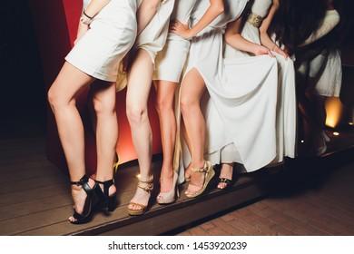 Close up of elegant female legs walking away.