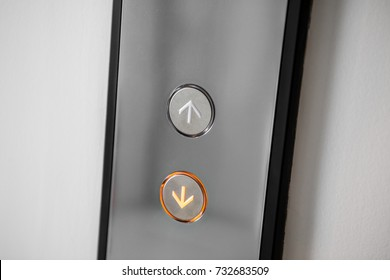 Close up elevator button over white wall.