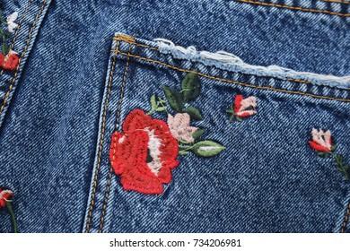Close up embroidered floral ,rose , Jeans skirt –pocket background