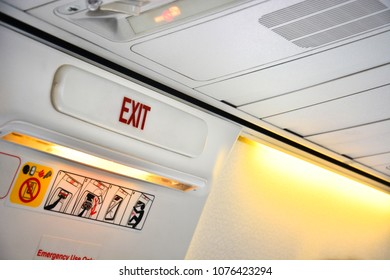 close up of emergency door exit sign in the aircraft