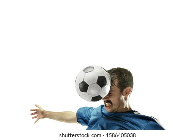 Close up of emotional caucasian man playing soccer hitting the ball with the head on isolated white background. Football, sport, facial expression, human emotions, healthy lifestyle concept. Copyspace