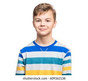 Close up emotional portrait of caucasian smiling teen boy. Head shot of handsome guy. Funny cut teenager, isolated on white background. Child looking at camera.